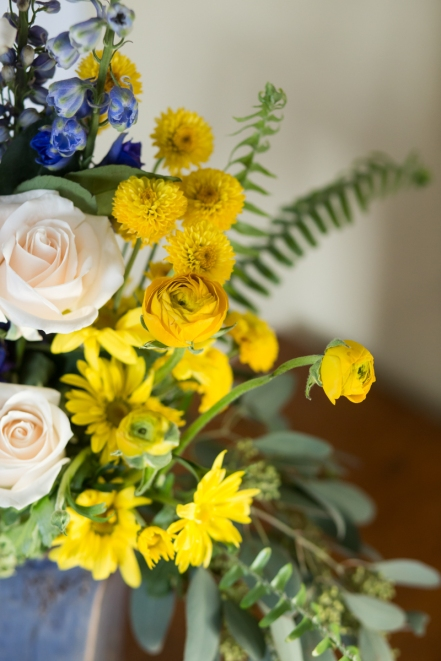 white rose yellow and blue fern outdoor centerpiece event